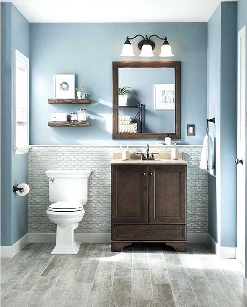 banheiro com piso e pastilhas cinza e paredes azuis