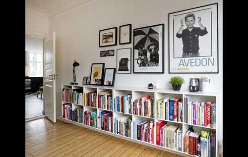 como decorar o corredor da sua casa com quadros e um aparador