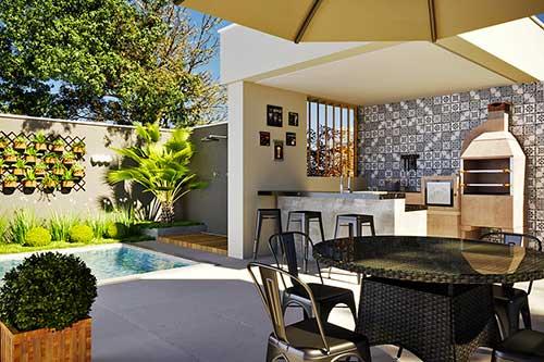 imagem de quintal com piscina e churrasqueira decorados