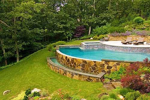 29 quintais com piscina dicas de paisagismo e decora o for Decorar piscina elevada