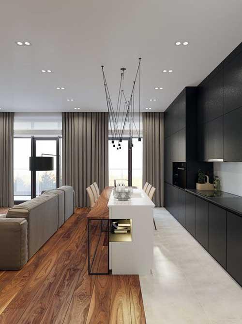 imagem de cozinha americana integrada a sala com pisos diferentes