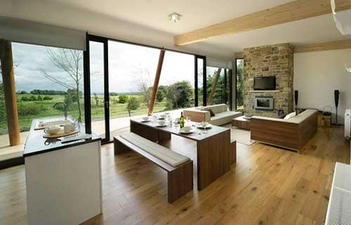 sala de estar e de jantar integradas a cozinha americana sem divisao