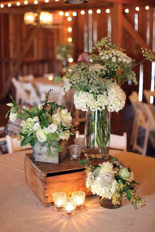 imagem de caixa de madeira decorada com vaso de plantas