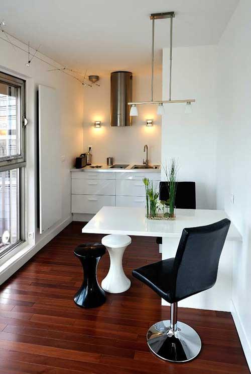 cozinha americana pequena integrada a sala