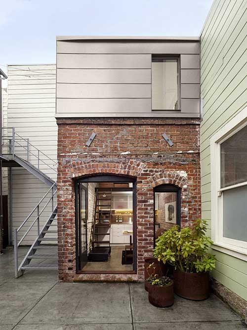 como decorar a fachada com tijolos