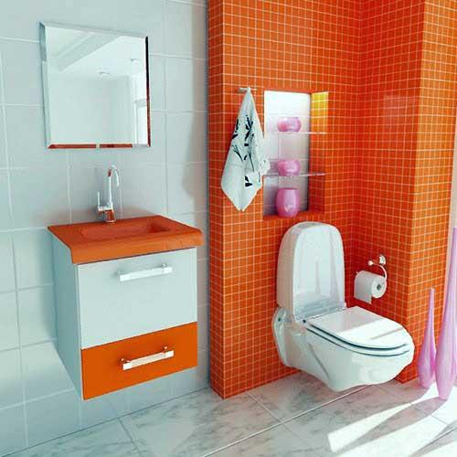 banheiro com pastilha de vidro laranja e moveis planejados