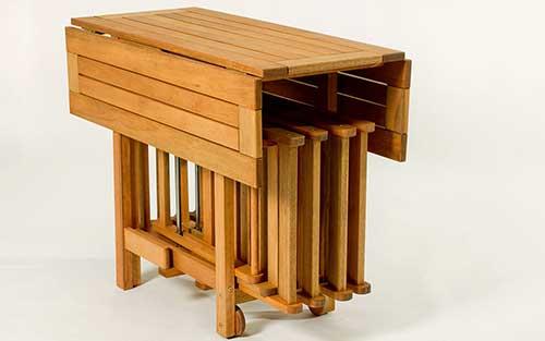 conjunto de mesa e cadeira em madeira para varanda gourmet