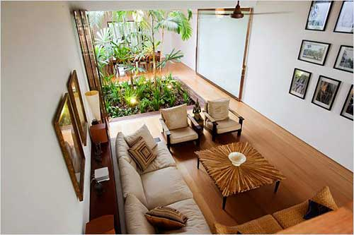 sala de estar grande com jardim de inverno