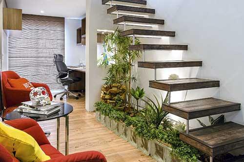 jardim de inverno decorado na sala de estar com tijolos de vidro