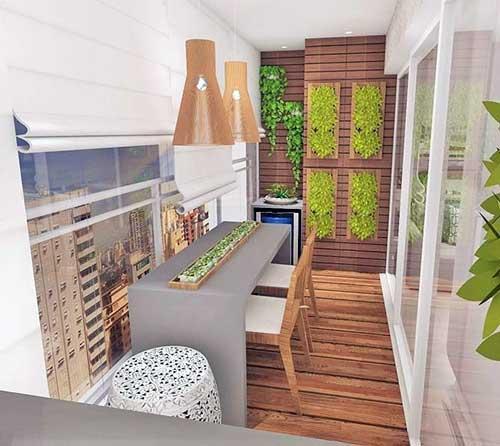 varanda gourmet com deck em madeira e jardim vertical