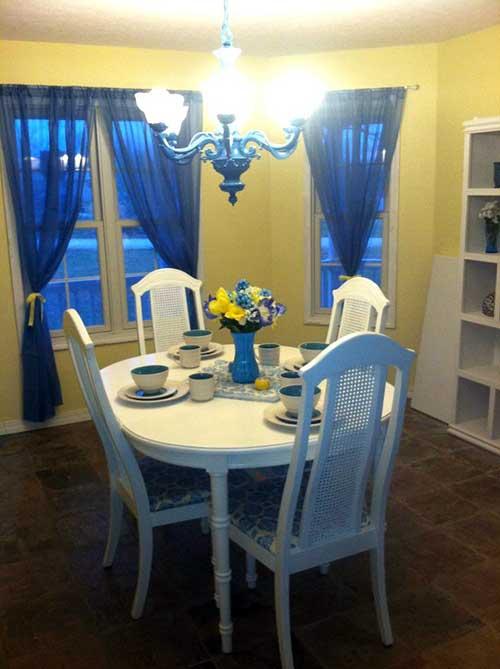 sala de jantar com pouco espaço colorida com azul e amarelo