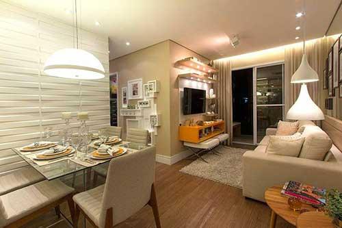 sala de estar e jantar em apartamento pequeno com mesa de vidro
