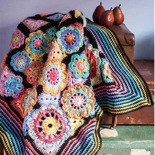 manta de croche com desenho floral colorido