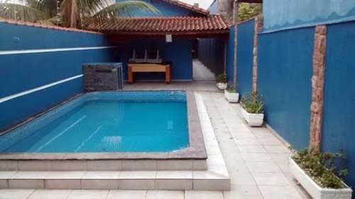 muro da piscina decorado com grafiato azul