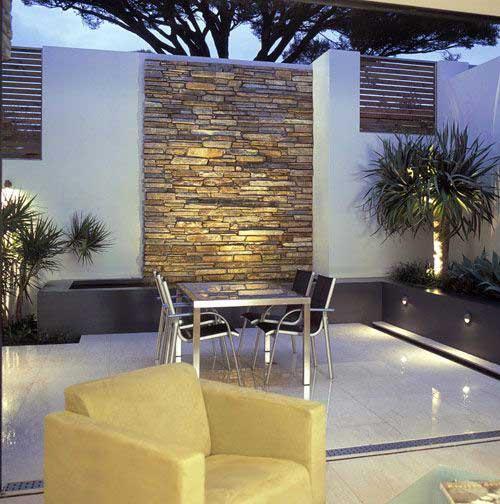 muro decorado com painel de pedras bonito