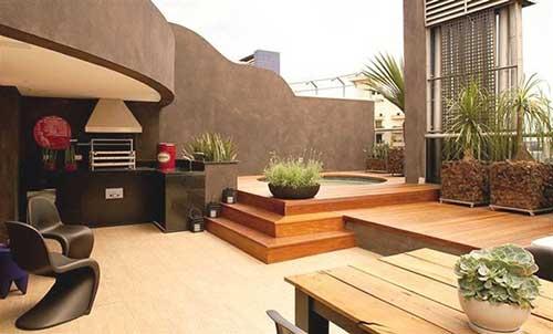 imagem do instagram de varanda gourmet com madeira e cimento queimado nas paredes