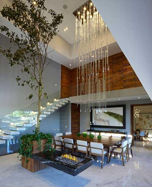 foto de sala grande com lustre grande e decoracao moderna