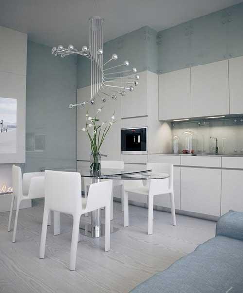 sala de jantar moderna com lustre diferenciado
