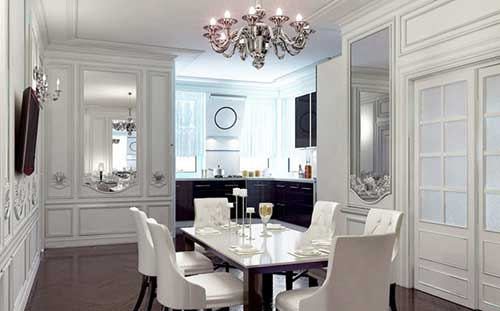 sala de jantar branca com lustre de metal
