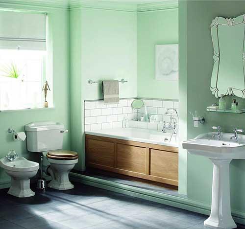 foto do pinterest de banheiro com parede verde clara e piso negro