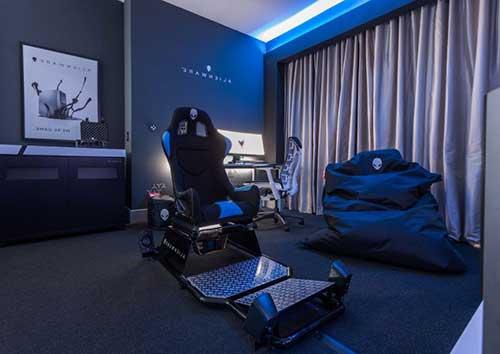 imagem de quarto gamer preto com led azul