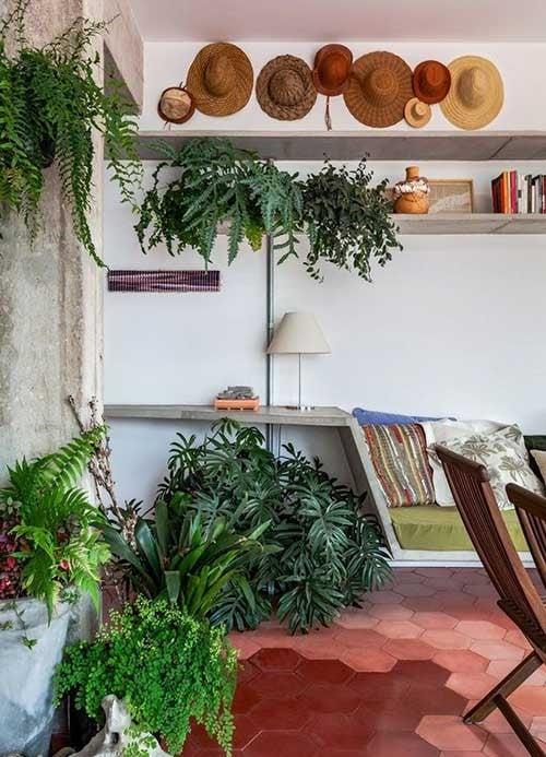 foto de sala de jantar com sofa e jardim de inverno