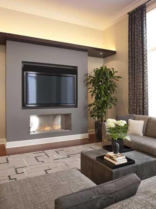 sala de estar com tv moderna com lareira eletrica