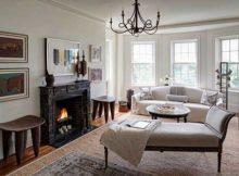 foto de sala de estar com lareira diferenciada e bonita