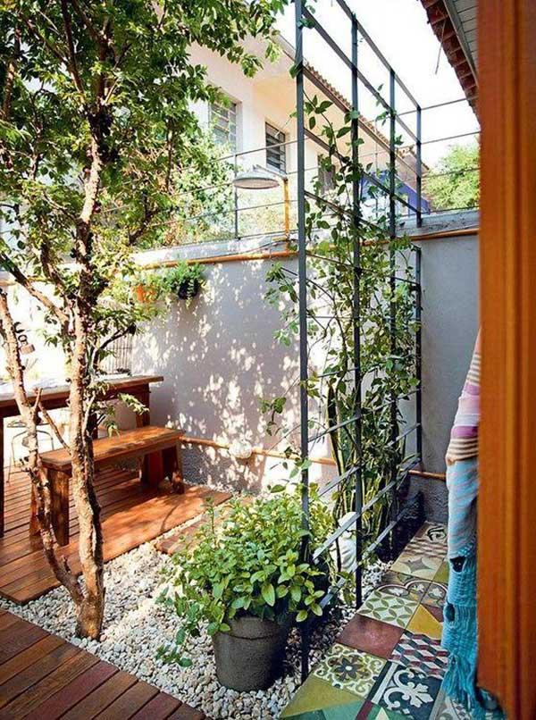 outra combinação legal é o trio cerâmica, madeira e pedra que, como você pode ver na foto, combina muito bem para o jardim nos fundos da casa