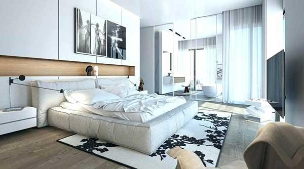 as paredes de vidro transparentes seguem o esquema de cores claras do quarto, que ainda conta com um belo tapete preto e branco