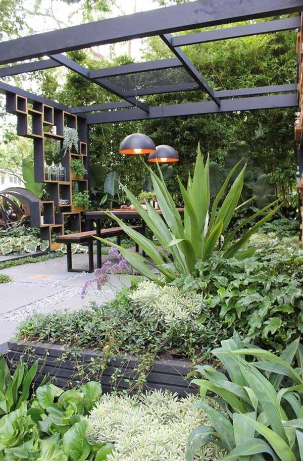 esse jardim contemporâneo ganha um toque de modernidade com as pedras cinza, a nova cor da decoração moderna