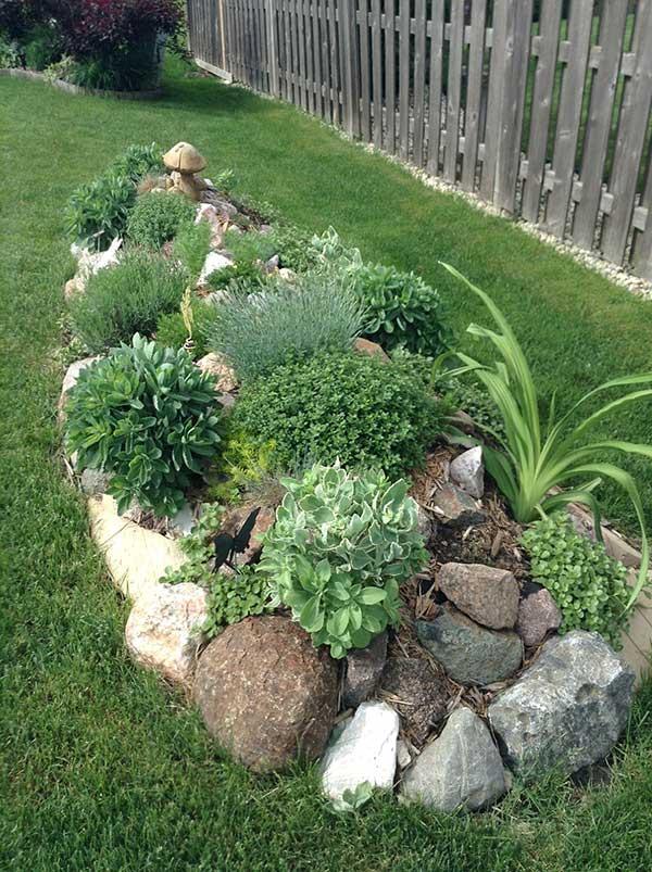 outro exemplo combinando pedra e grama e mais um pequeno nicho com belas plantinhas