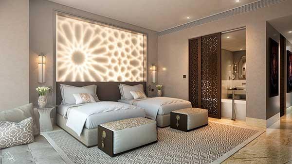 para esse quarto de irmãs gêmeas, um lindo painel de luzes formando uma flor traz charme à decoração